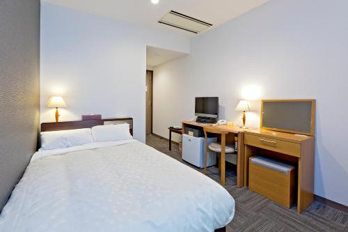 A bed or beds in a room at Hotel New Ohte