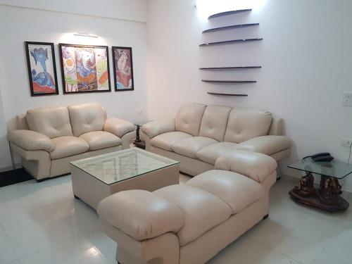 A seating area at Lake View 3 BHK Flat