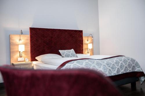 Ein Bett oder Betten in einem Zimmer der Unterkunft Hotel Elefant Family Business