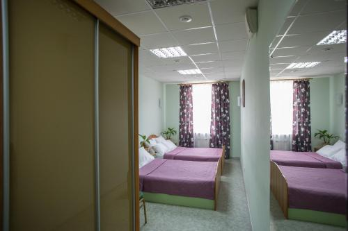 A bed or beds in a room at Hotel Stara Zagora