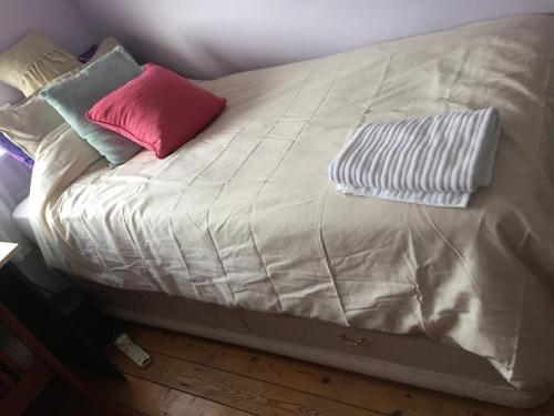 A bed or beds in a room at B Homestay