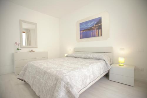 A bed or beds in a room at Residence Dolce Vita