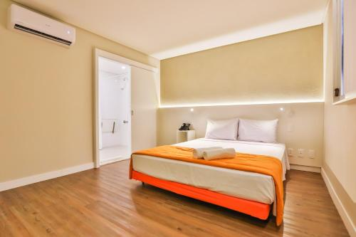 A bed or beds in a room at Go Inn Serra