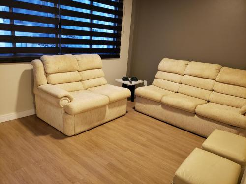 A seating area at Apartamento Vila Real