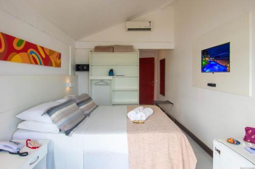 Cama o camas de una habitación en Chez Pitu Praia Hotel