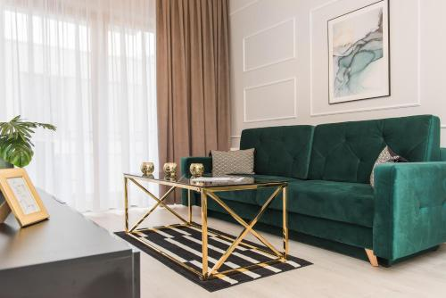 A seating area at Bed&Bath Luxury Apartments