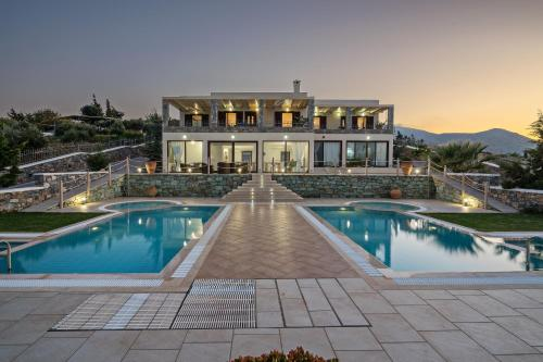 The swimming pool at or close to Villas Anemomilos