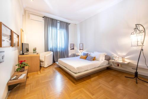 A bed or beds in a room at Hidesign Athens Luxury Apartments in Kolonaki