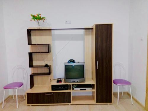 A television and/or entertainment centre at Апартаменты «Татьяна»