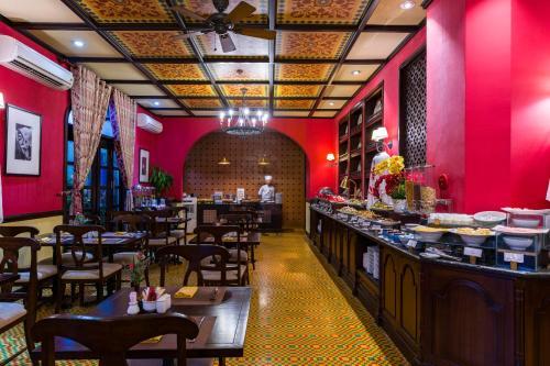 Ein Restaurant oder anderes Speiselokal in der Unterkunft La Residencia . A Little Boutique Hotel & Spa