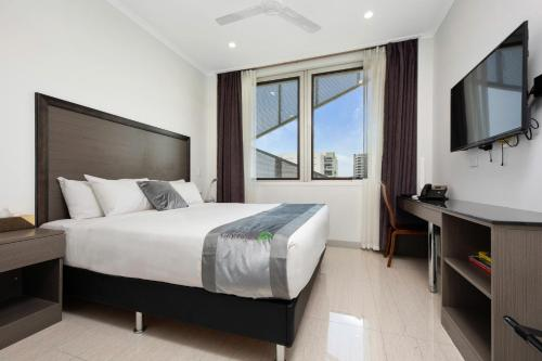 A bed or beds in a room at Darwin City Hotel