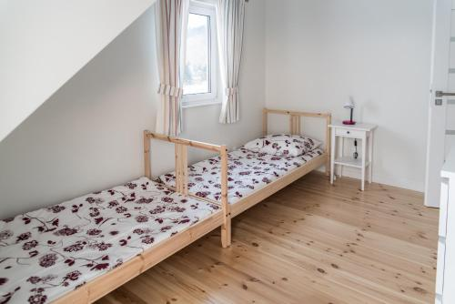 A bed or beds in a room at Na Fali