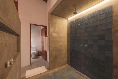Um banheiro em Pousada Reserva do Patacho