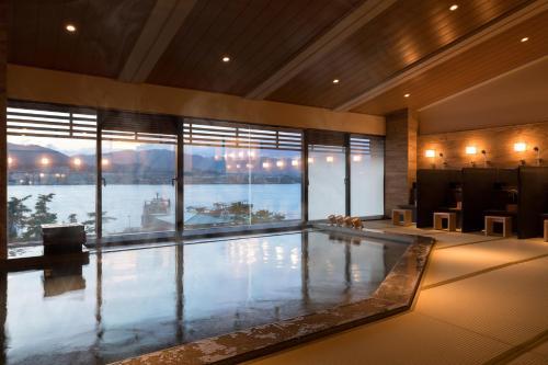 The swimming pool at or near Hotel Miyajima Villa