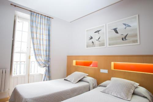 A bed or beds in a room at Casa Celsa-Barbantes