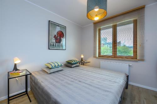 Postel nebo postele na pokoji v ubytování Apartament Praski Sen