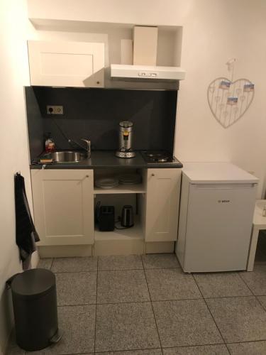 Een keuken of kitchenette bij Apartment de Boer