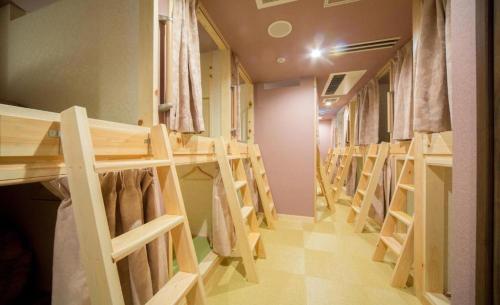 A bunk bed or bunk beds in a room at HOSTEL WASABI Nagoya Ekimae