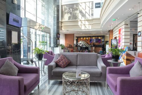 The lobby or reception area at Signature 1 Hotel Tecom