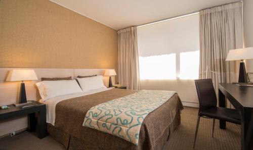 Cama o camas de una habitación en Hotel Alborada