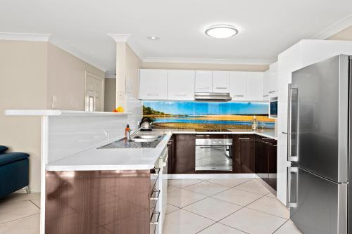 A kitchen or kitchenette at Blue Haze 3 - Sawtell, NSW