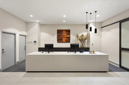 The lobby or reception area at Quest Orange