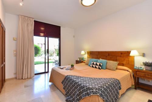 Cama o camas de una habitación en Villas Tauro Golf