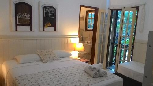 A bed or beds in a room at Recanto da Praia