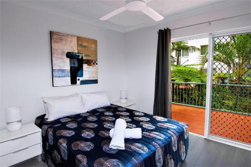 A bed or beds in a room at Grande Florida Beachside Resort