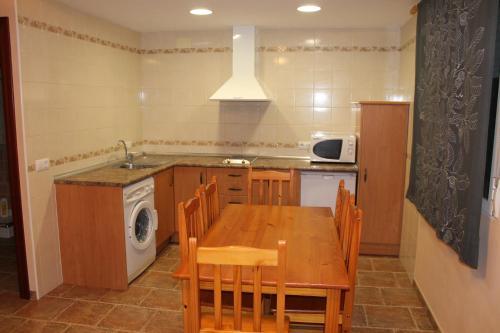 A kitchen or kitchenette at Apartahotel Laguna de Gallocanta
