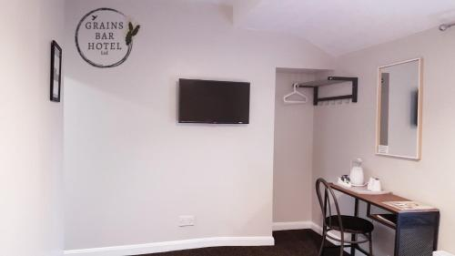 A television and/or entertainment center at Grains Bar Hotel