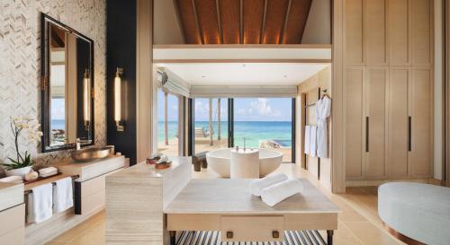 A seating area at Waldorf Astoria Maldives Ithaafushi