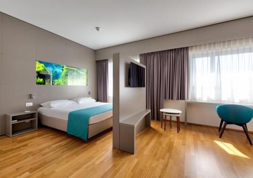 Ein Bett oder Betten in einem Zimmer der Unterkunft Aquatis Hotel 3* Superior