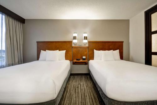 A bed or beds in a room at Hyatt Place Columbus Worthington