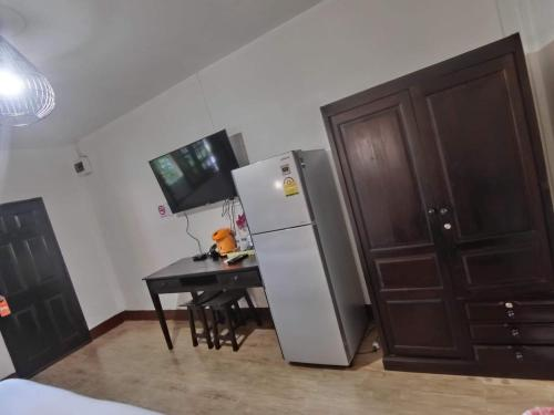 A television and/or entertainment center at The Krabi Forest Homestay