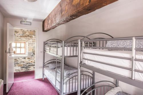 A bunk bed or bunk beds in a room at Old Mill Holiday Hostel