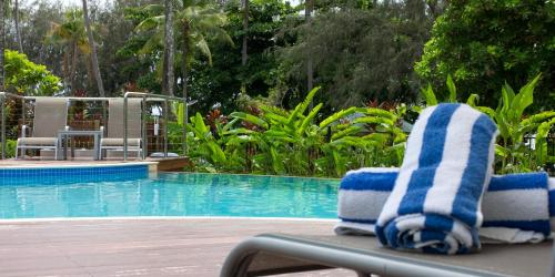 The swimming pool at or near Beaches Port Douglas Holiday Apartments Book Here With The Onsite Reception Team
