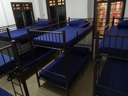 A bunk bed or bunk beds in a room at Homey Hostel