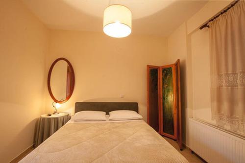 Ένα ή περισσότερα κρεβάτια σε δωμάτιο στο Οδός Ονείρων