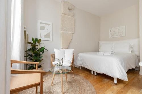 A bed or beds in a room at Appartement Vertus