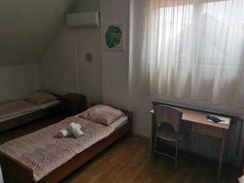 Krevet ili kreveti u jedinici u objektu Stari Grad