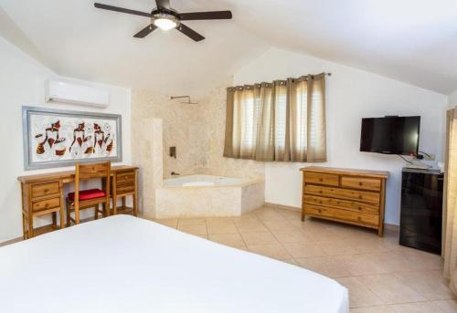 A bed or beds in a room at Albachiara Hotel - Las Terrenas