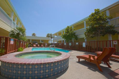 The swimming pool at or near Plantation Suites and Conference Center