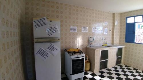A cozinha ou cozinha compacta de Soul Hostel Natal