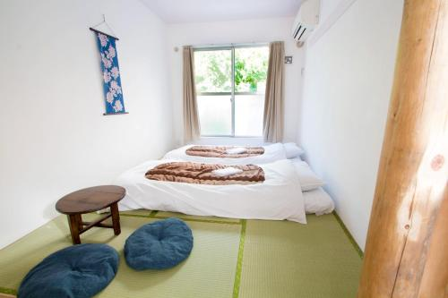 A bed or beds in a room at Sakura Hotel Nippori