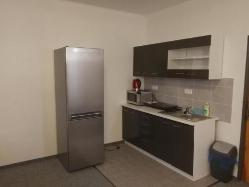 A kitchen or kitchenette at Hotel M&M