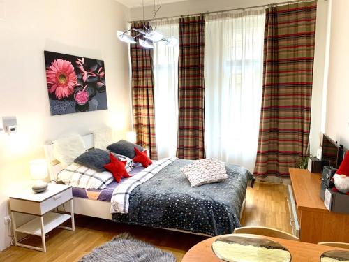 Postel nebo postele na pokoji v ubytování Opatovicka