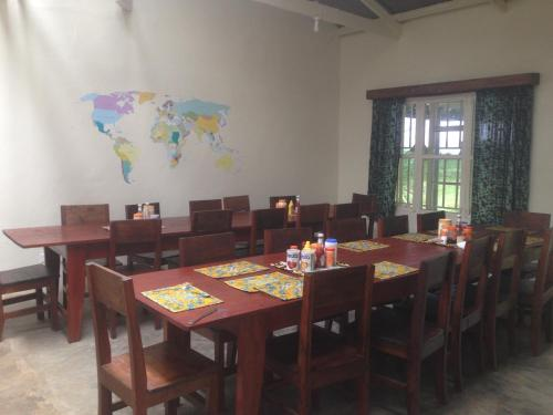 A restaurant or other place to eat at Bwindi Guest House