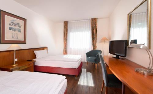 Ein Bett oder Betten in einem Zimmer der Unterkunft Wyndham Garden Hennigsdorf Berlin