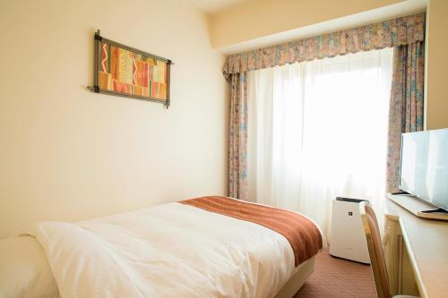 A bed or beds in a room at ANA Holiday Inn Resort Miyazaki